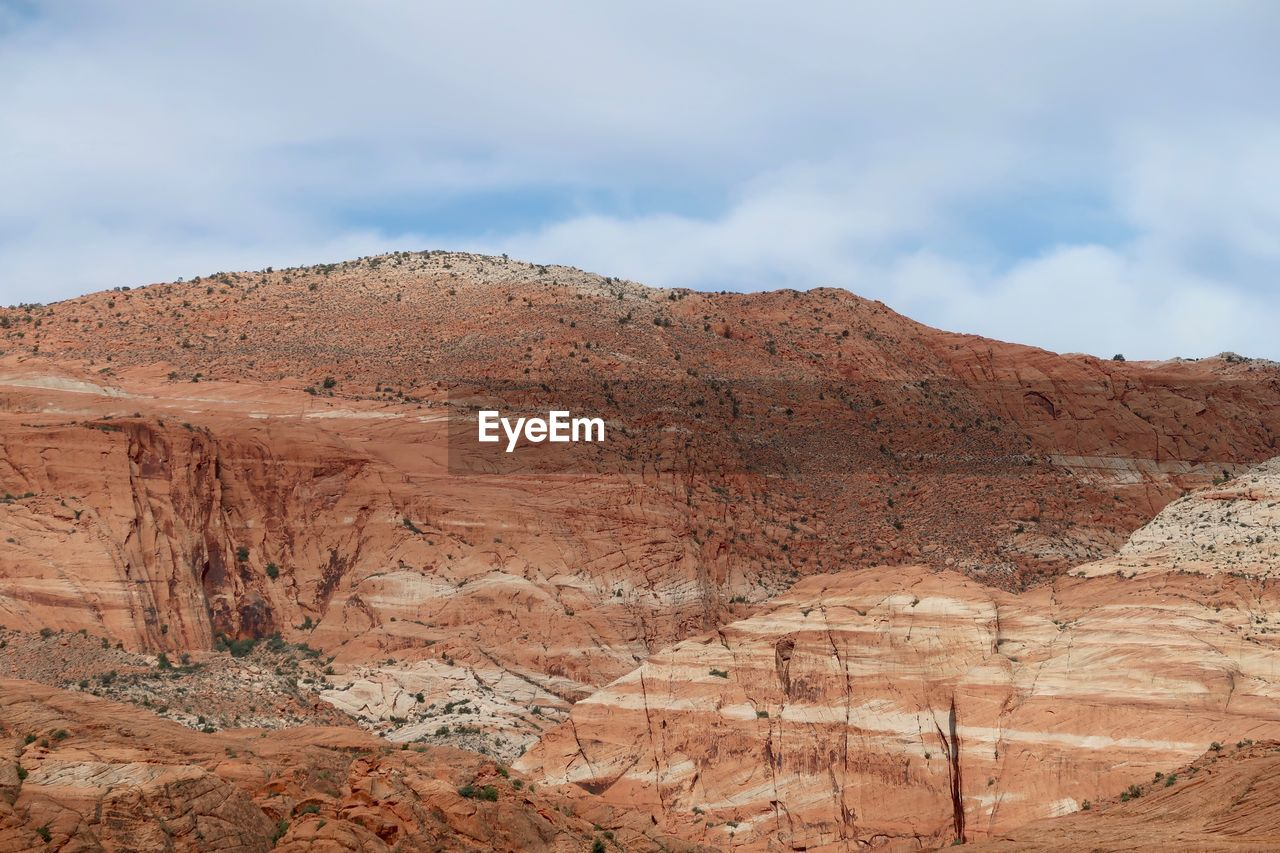 scenics - nature, rock, sky, rock formation, tranquil scene, non-urban scene, rock - object, beauty in nature, mountain, landscape, environment, cloud - sky, tranquility, physical geography, solid, geology, remote, nature, desert, day, no people, mountain range, climate, arid climate, formation, eroded, outdoors