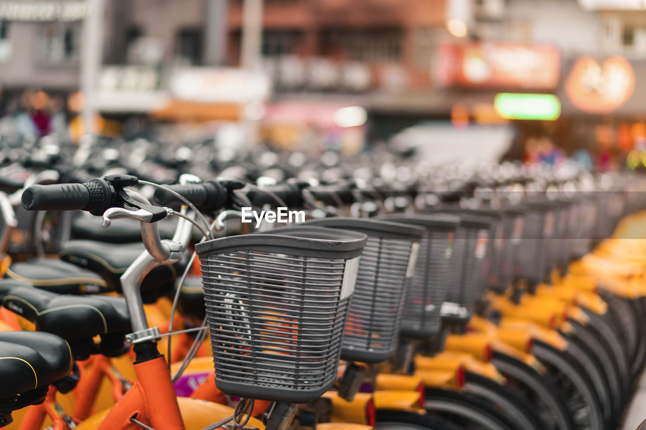 CLOSE-UP OF BICYCLES IN ROW AT MARKET