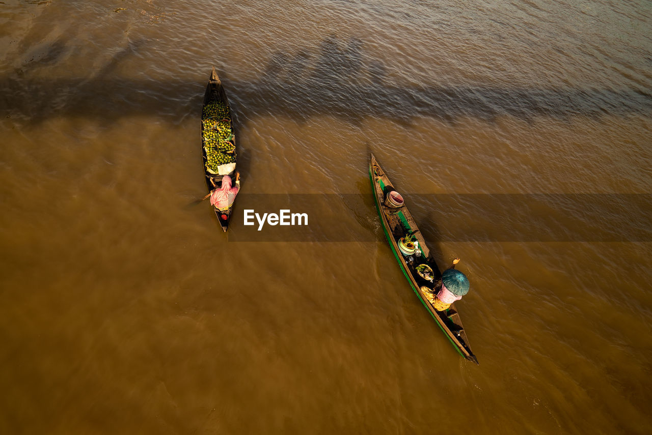 High angle view of floating market vendors in lake
