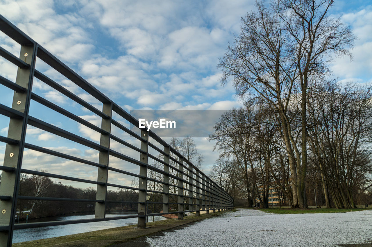 sky, tree, bare tree, cloud - sky, architecture, built structure, nature, plant, no people, day, transportation, bridge, outdoors, connection, winter, railing, water, bridge - man made structure, land