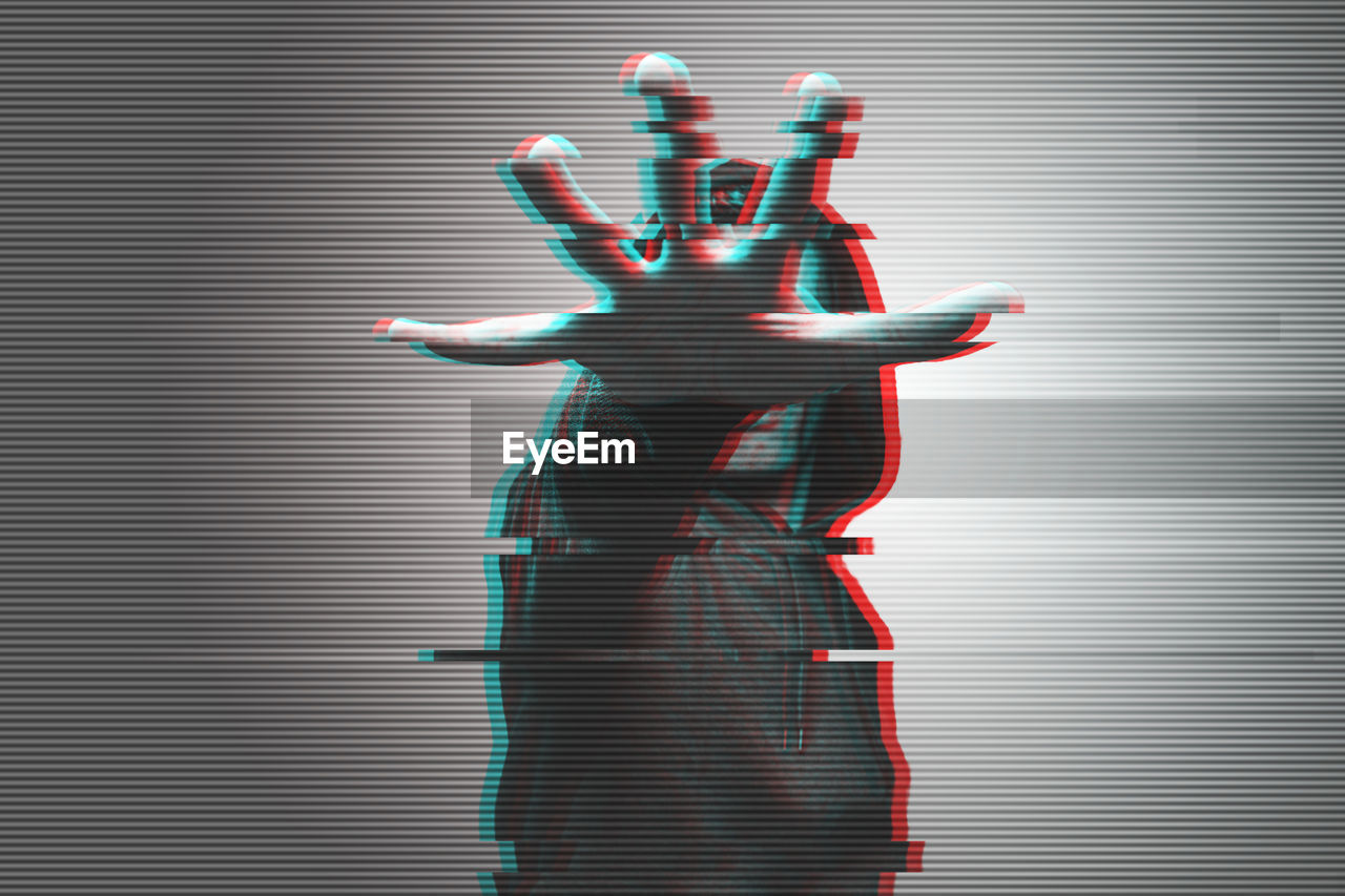 3d image of man gesturing against gray background