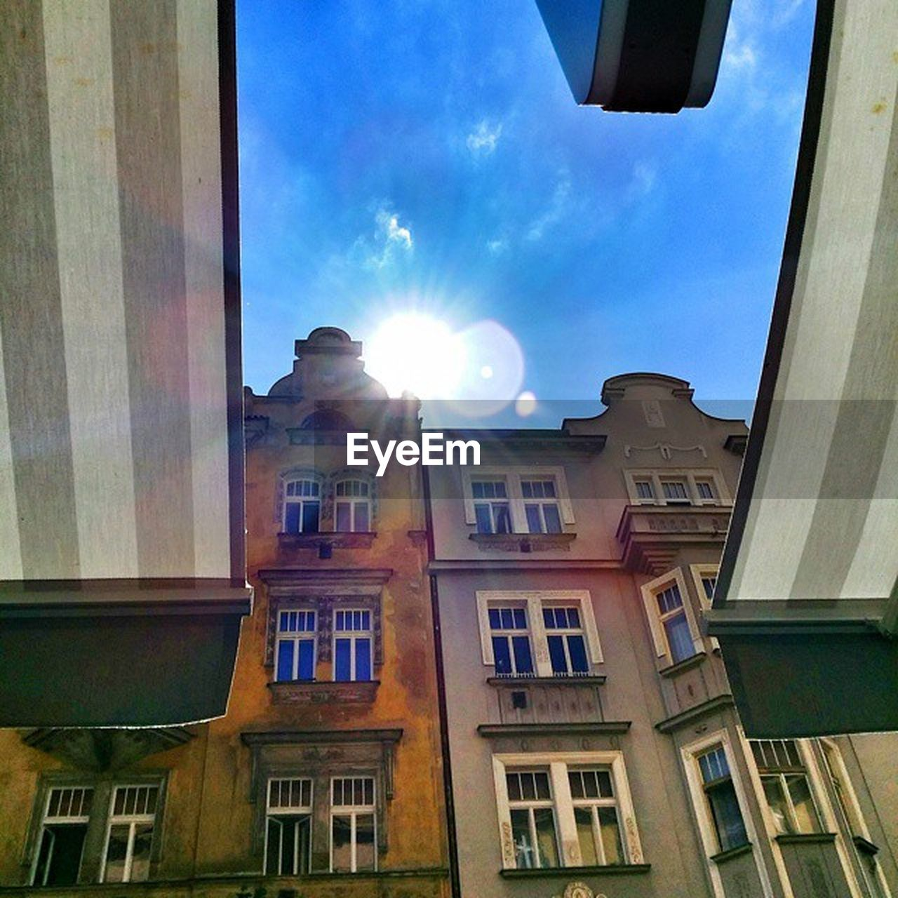 window, architecture, low angle view, sunlight, building exterior, built structure, no people, sky, day, sun, outdoors