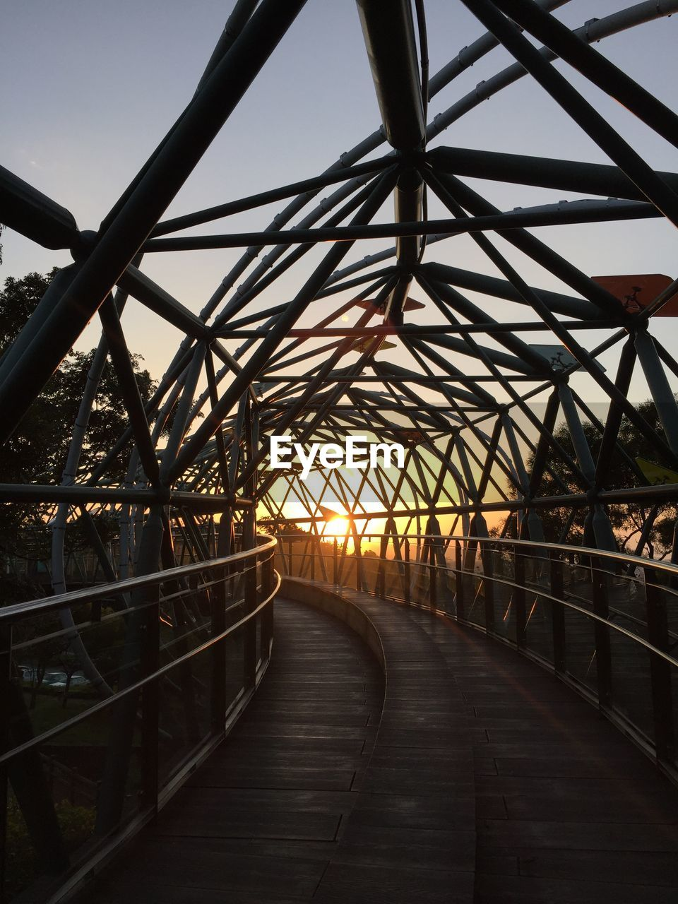 architecture, built structure, metal, the way forward, connection, direction, bridge, sky, bridge - man made structure, transportation, no people, diminishing perspective, railing, nature, day, outdoors, footbridge, footpath, rail transportation, track, iron - metal, long, steel