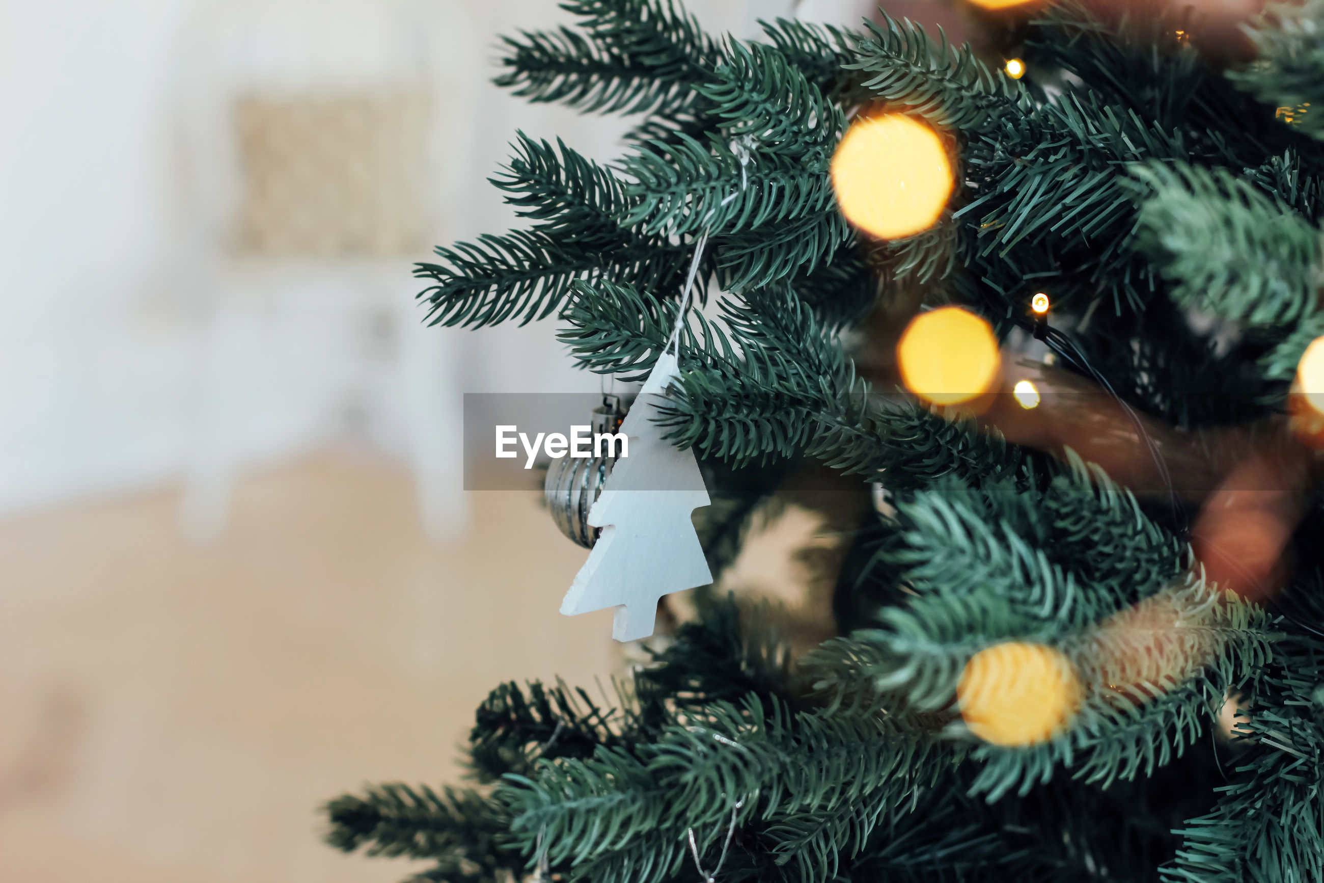 Close-up of decorations hanging on christmas tree at home
