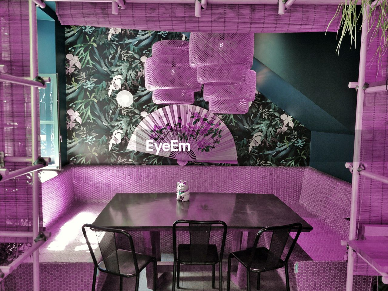 chair, seat, table, absence, business, no people, restaurant, indoors, plant, pink color, empty, furniture, arrangement, purple, architecture, flowering plant, nature, flower, wood - material, setting, flower pot
