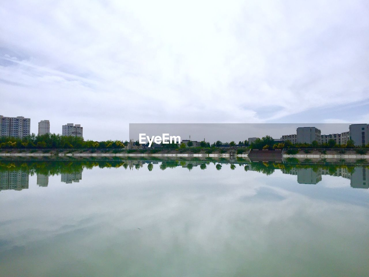 Reflection Of Buildings In Lake