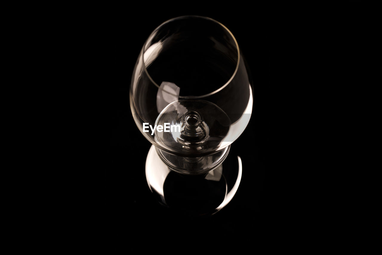 High angle view of empty wineglass against black background