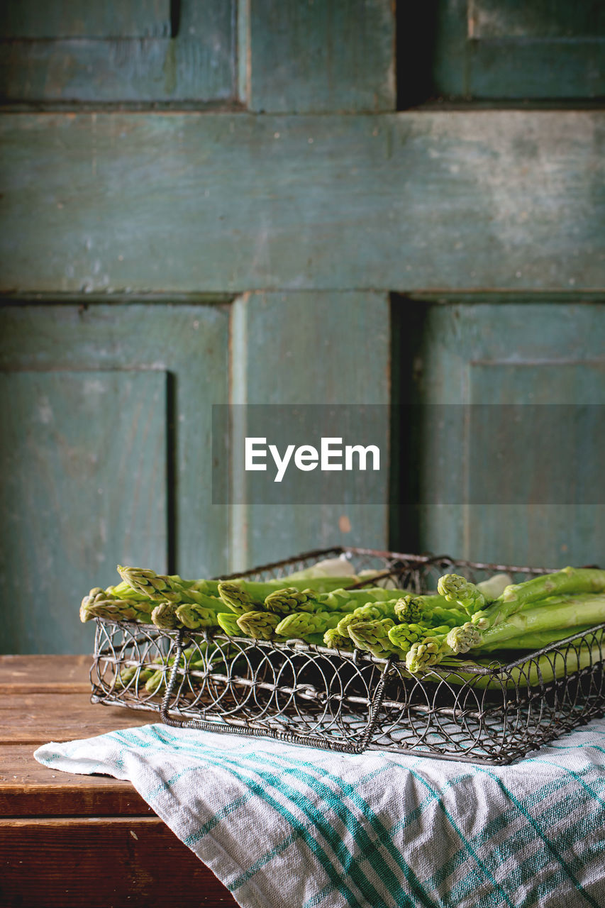 Close-Up Of Asparagus In Wire Basket