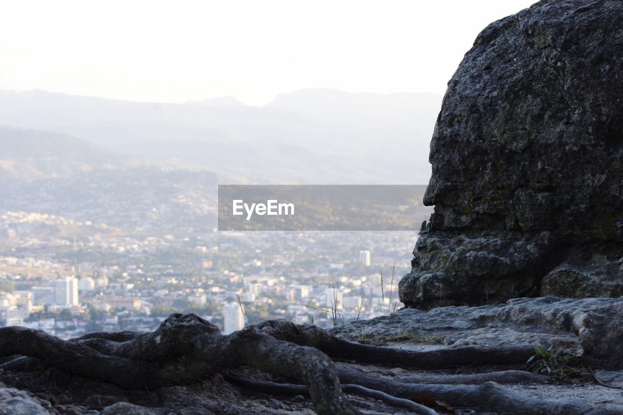 View Of Cityscape Against Mountain