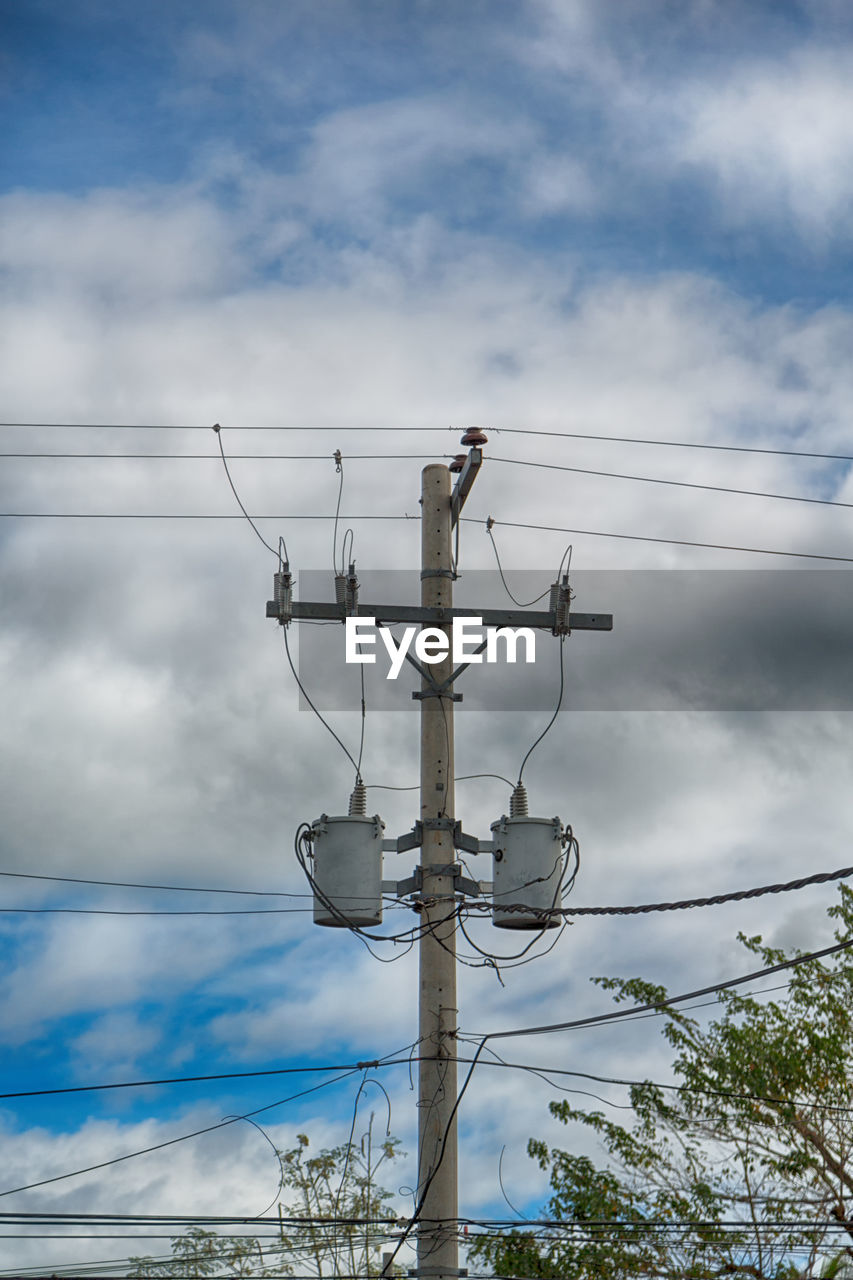 cloud - sky, sky, low angle view, cable, connection, electricity, power line, power supply, nature, technology, electricity pylon, day, no people, fuel and power generation, outdoors, complexity, communication, tree, lighting equipment, telephone line, electrical equipment
