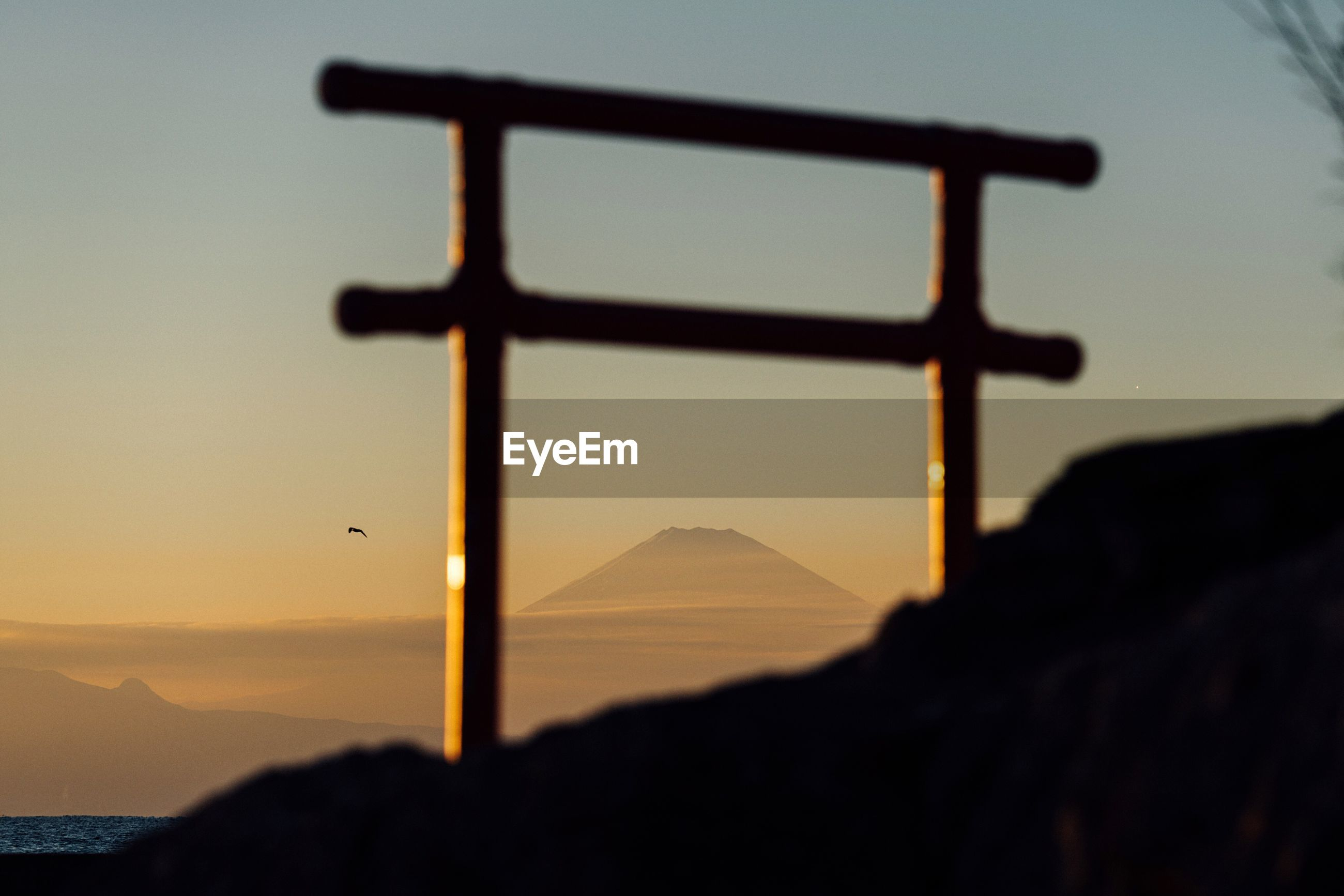 CLOSE-UP OF SILHOUETTE MOUNTAIN AGAINST SKY DURING SUNSET