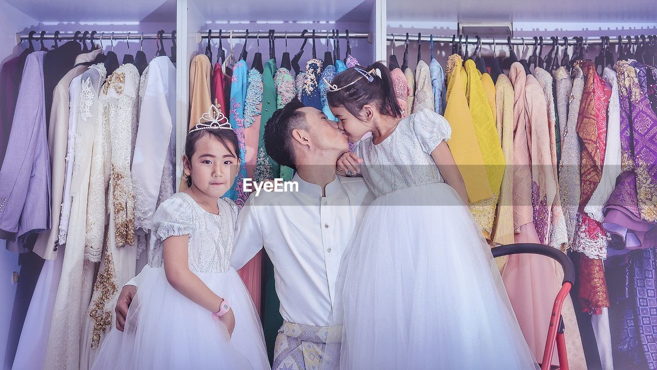 clothing, women, fashion, store, clothing store, adult, retail, shopping, rack, choice, young adult, lifestyles, happiness, business, dress, emotion, two people, young women, indoors, smiling, consumerism, positive emotion, retail display, boutique