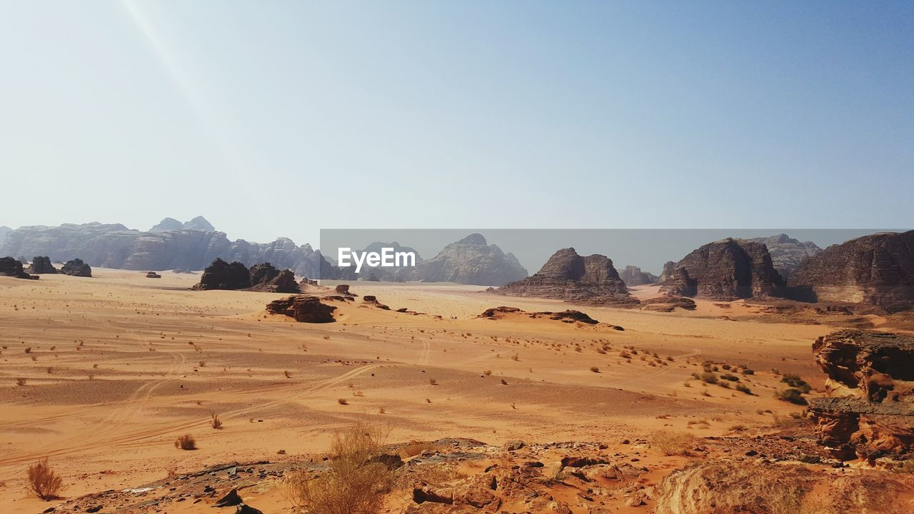 landscape, environment, sky, tranquil scene, mountain, scenics - nature, tranquility, beauty in nature, nature, non-urban scene, land, desert, no people, clear sky, day, mountain range, copy space, sunlight, rock, arid climate, climate, outdoors