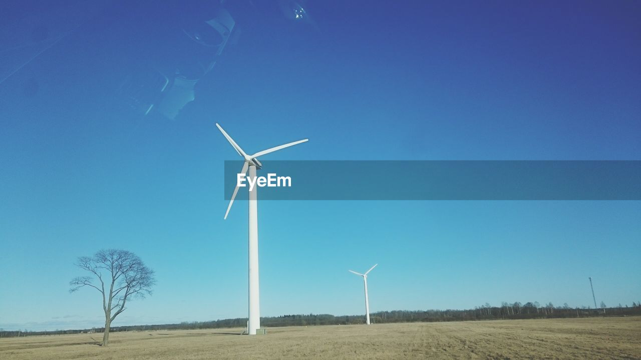 wind power, wind turbine, alternative energy, environmental conservation, renewable energy, windmill, fuel and power generation, industrial windmill, rural scene, blue, field, outdoors, day, landscape, traditional windmill, sky, clear sky, no people, nature, technology, beauty in nature, tree