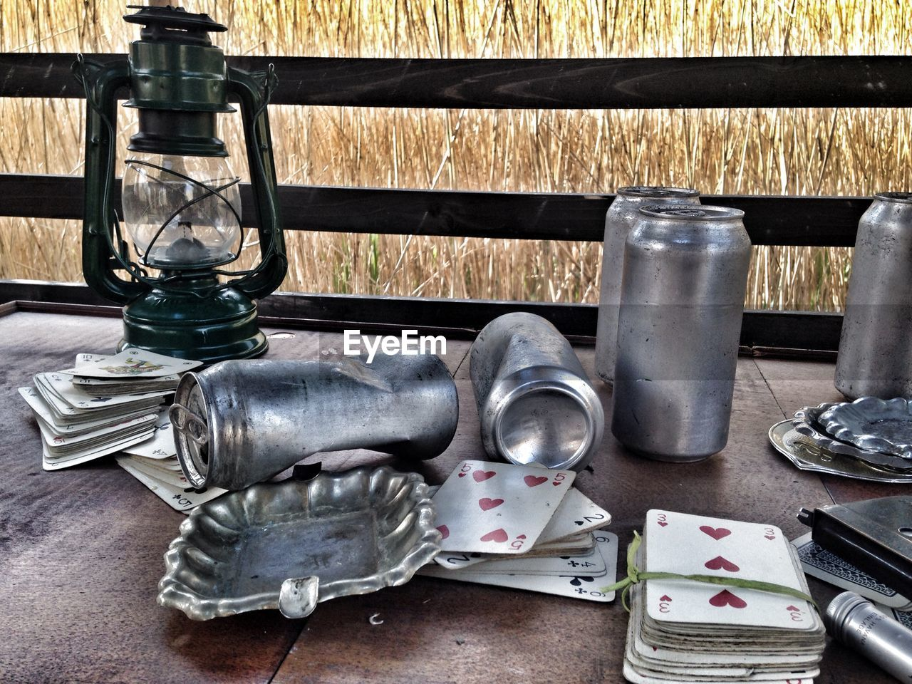 HIGH ANGLE VIEW OF OLD GLASSES AND TABLE