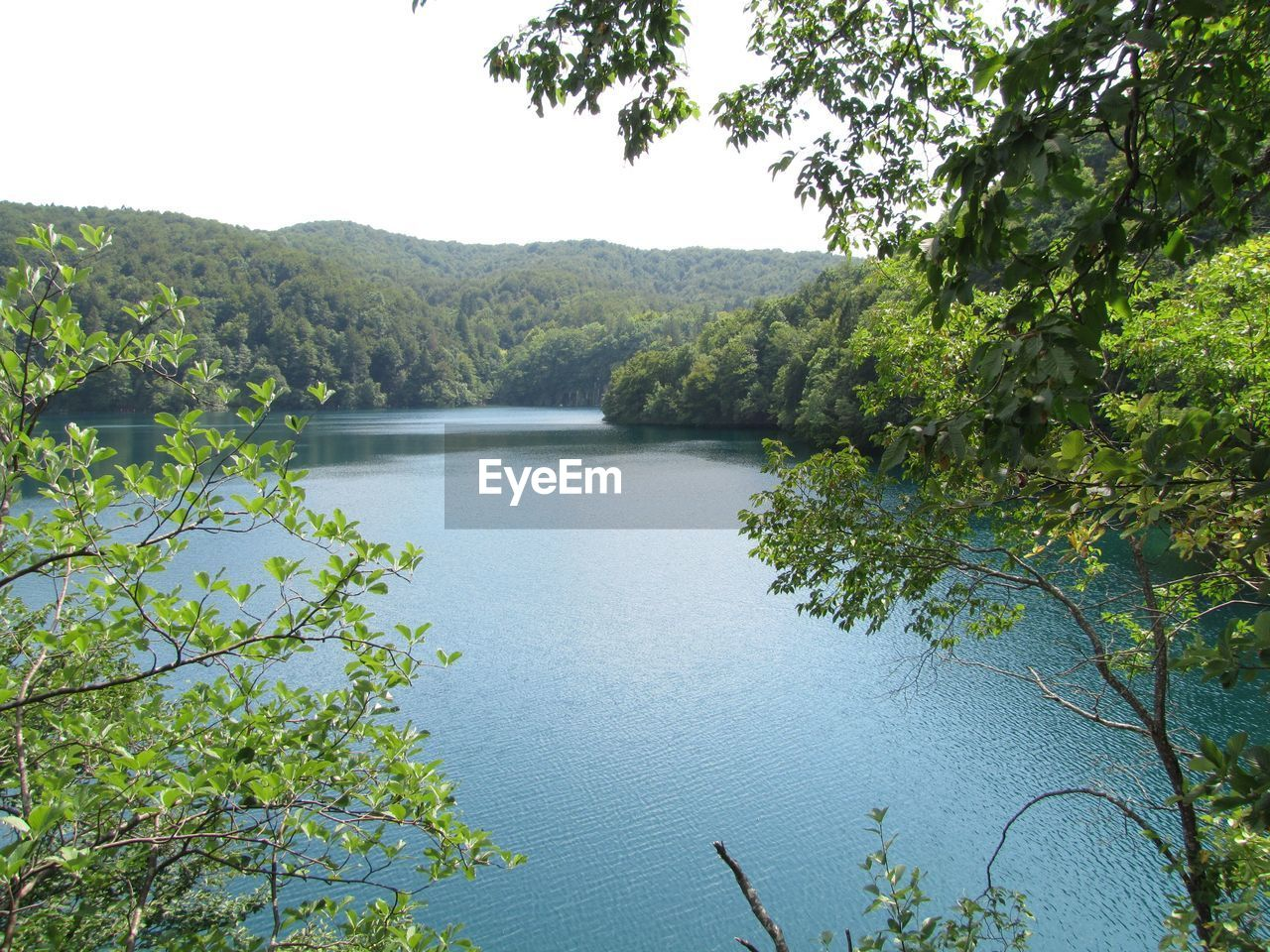 Scenic View Of Lake And Mountains At Plitvice Lakes National Park