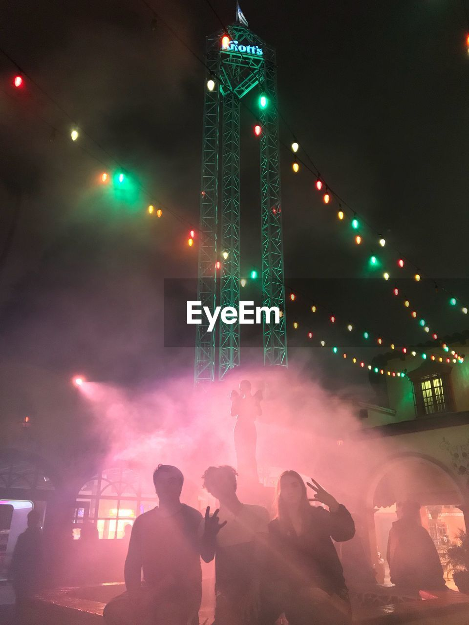 illuminated, real people, celebration, night, men, leisure activity, lifestyles, large group of people, outdoors, togetherness, women, architecture