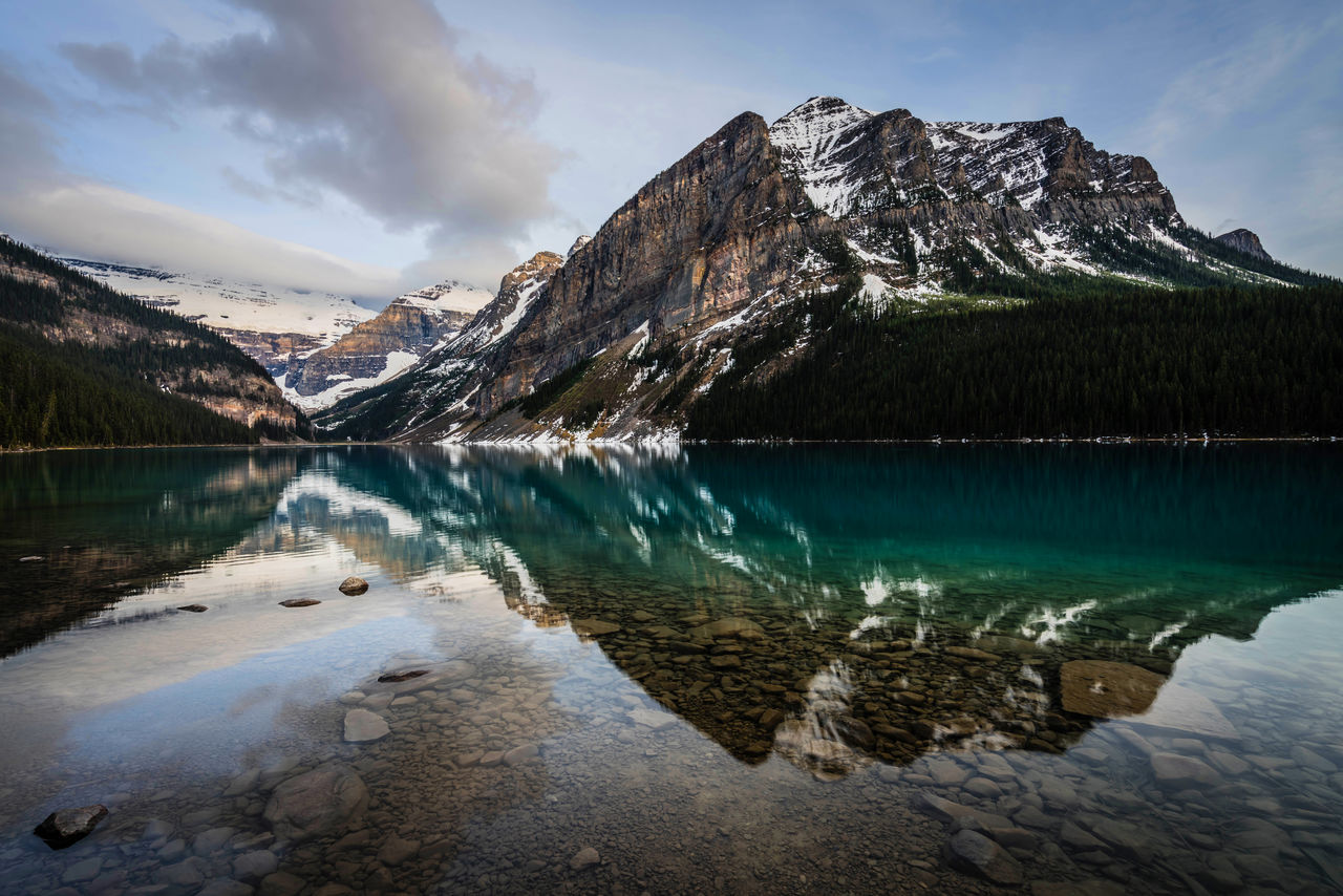 water, mountain, scenics - nature, lake, beauty in nature, tranquil scene, tranquility, sky, cloud - sky, reflection, mountain range, nature, cold temperature, non-urban scene, idyllic, winter, snow, day, no people, outdoors, ice, snowcapped mountain, formation, turquoise colored, reflection lake