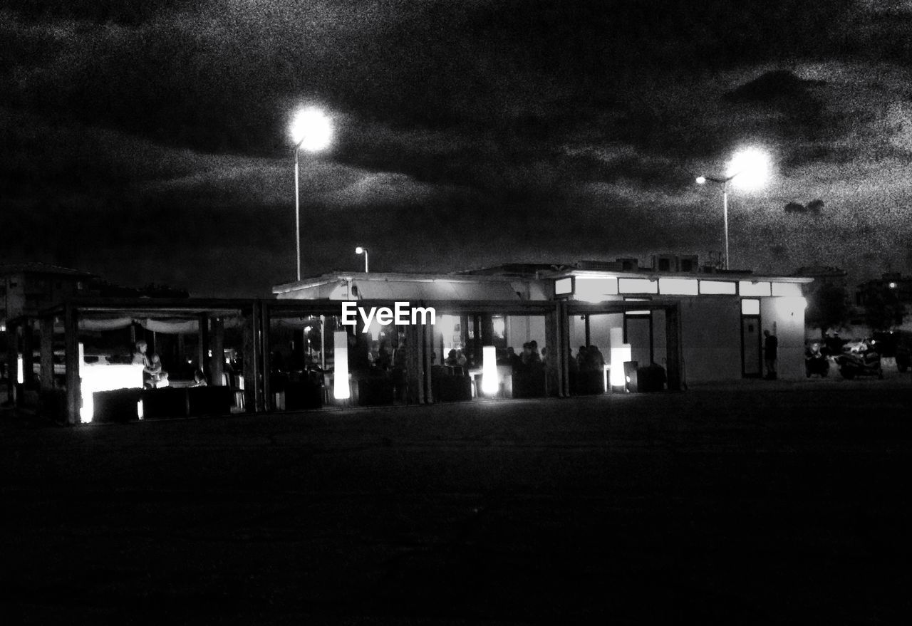 night, illuminated, gas station, fuel pump, refueling, outdoors, sky, fuel and power generation, built structure, moon, oil industry, building exterior, no people