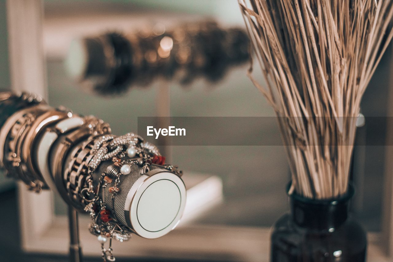 Close-up of jewelry by vase