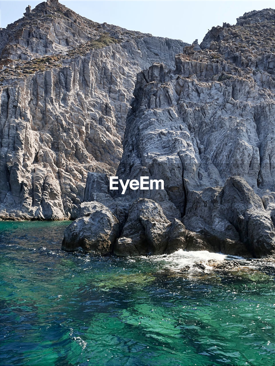 water, rock, rock - object, waterfront, solid, nature, beauty in nature, rock formation, day, tranquil scene, tranquility, scenics - nature, no people, sea, non-urban scene, geology, idyllic, physical geography, mountain, outdoors, formation, eroded, turquoise colored, flowing water