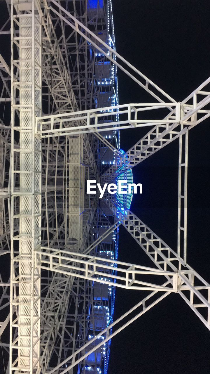 architecture, night, built structure, metal, low angle view, illuminated, blue, connection, complexity, no people, construction site, girder, industry, technology, building exterior, outdoors, city, close-up