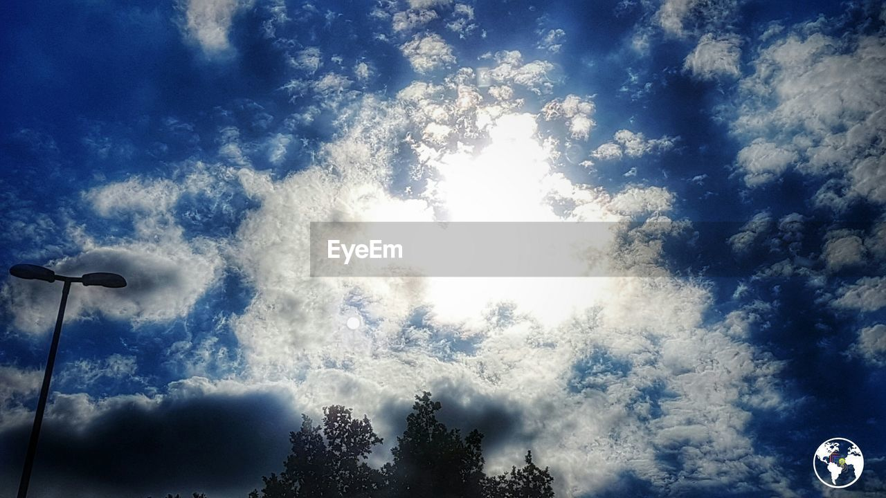 sky, low angle view, cloud - sky, tree, day, street light, outdoors, nature, no people, beauty in nature
