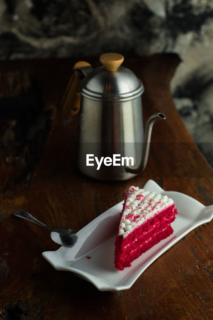 food and drink, food, kitchen utensil, freshness, table, eating utensil, sweet food, still life, indoors, no people, indulgence, spoon, ready-to-eat, cake, focus on foreground, dessert, sweet, wood - material, fruit, close-up, temptation, slice of cake