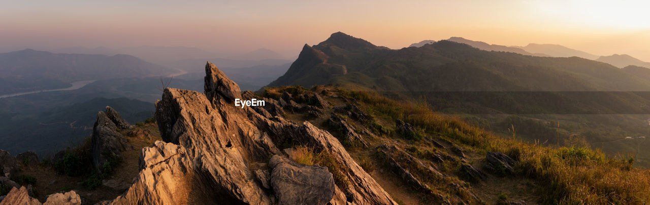 Panoramic view of mountain range against sky during sunset