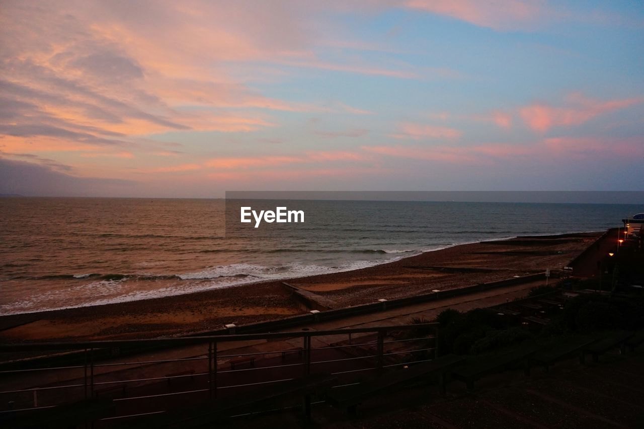 Scenic view of beach and sea against sky during sunset