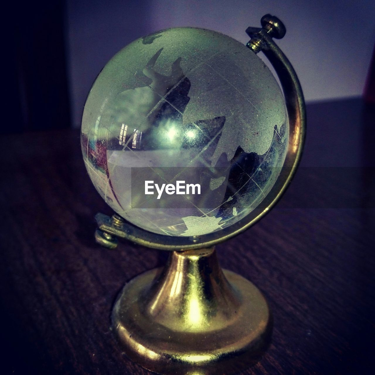 close-up, reflection, crystal ball, indoors, old-fashioned, no people, illuminated, day