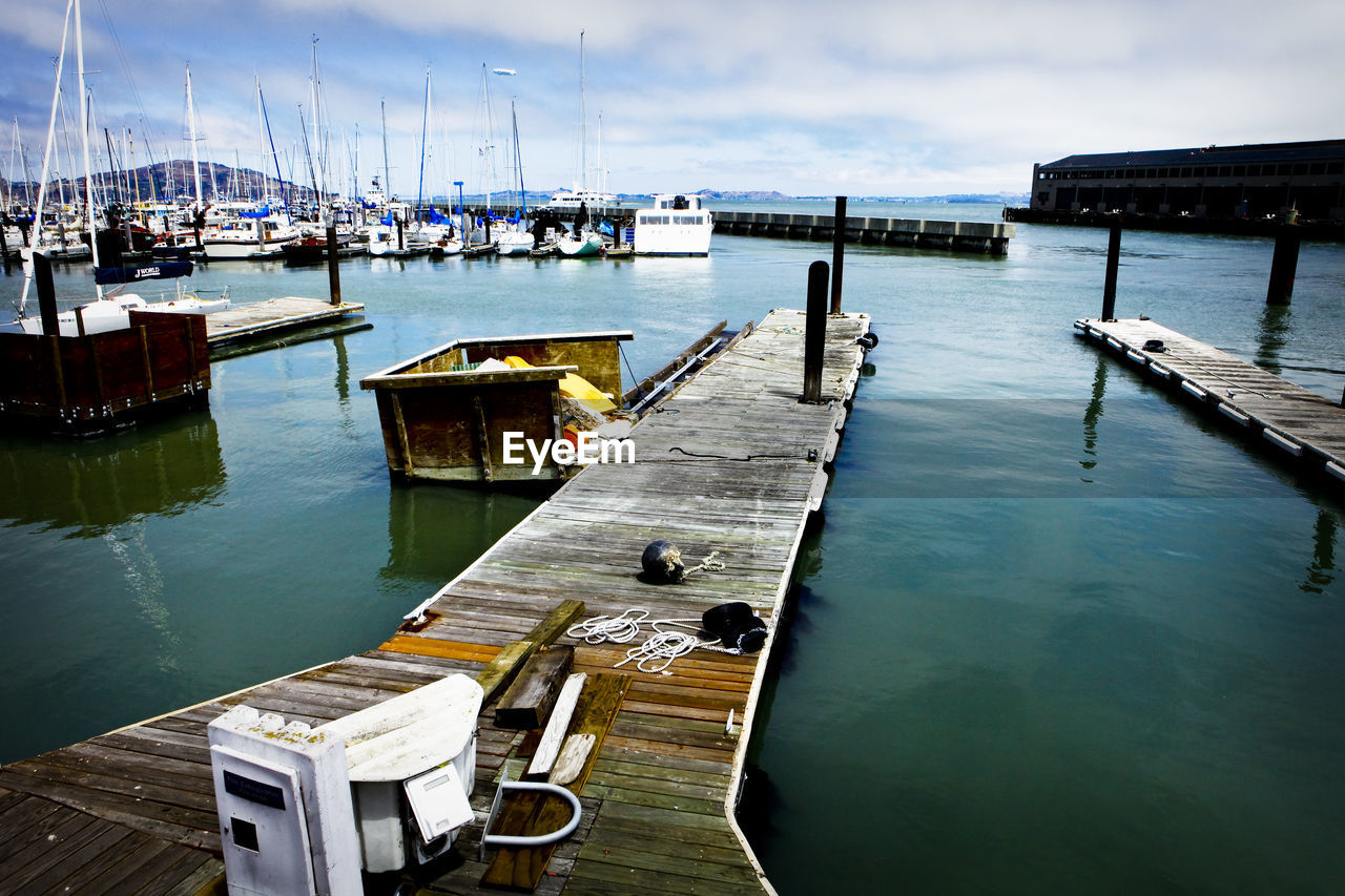 water, nautical vessel, transportation, moored, pier, day, mode of transport, wood - material, no people, harbor, nature, outdoors, sky, sea, built structure, animal themes