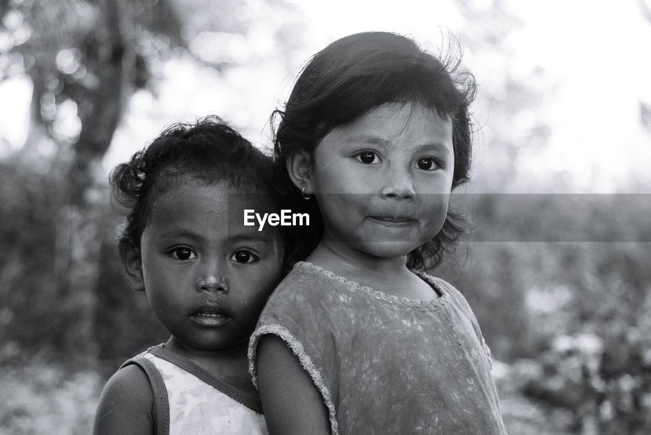 Portrait Of Cute Siblings