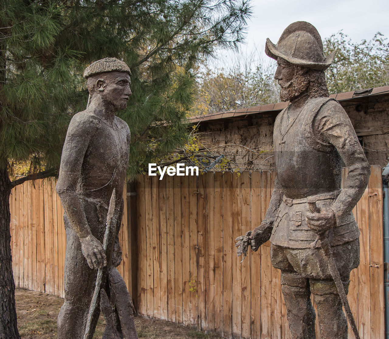 representation, sculpture, statue, human representation, male likeness, art and craft, craft, creativity, tree, no people, day, plant, nature, park, architecture, park - man made space, female likeness, carving - craft product, wood - material, stone material
