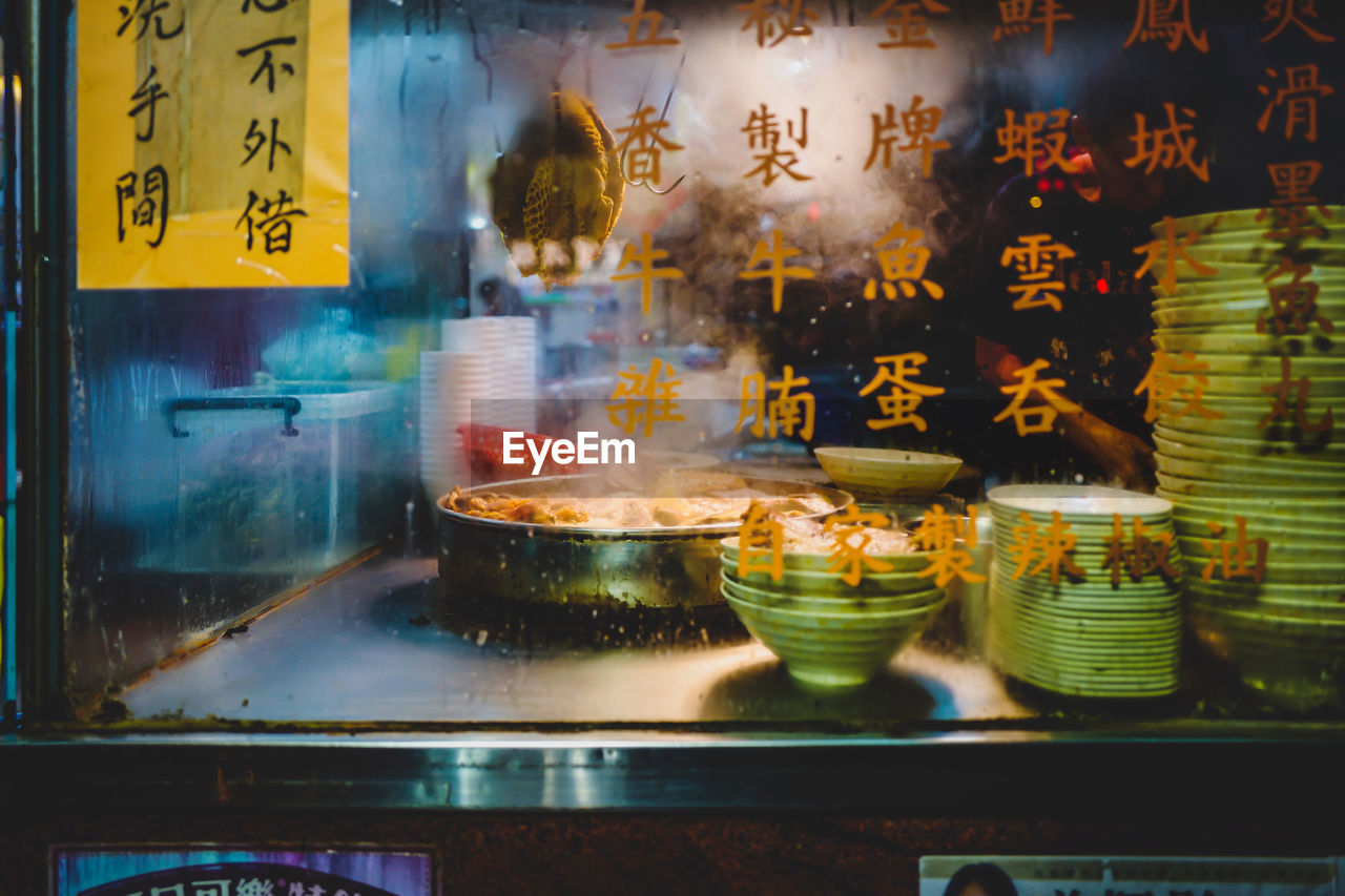 food, food and drink, freshness, indoors, no people, glass - material, restaurant, transparent, ready-to-eat, retail, for sale, business, still life, communication, text, script, large group of objects, asian food, close-up, store, snack