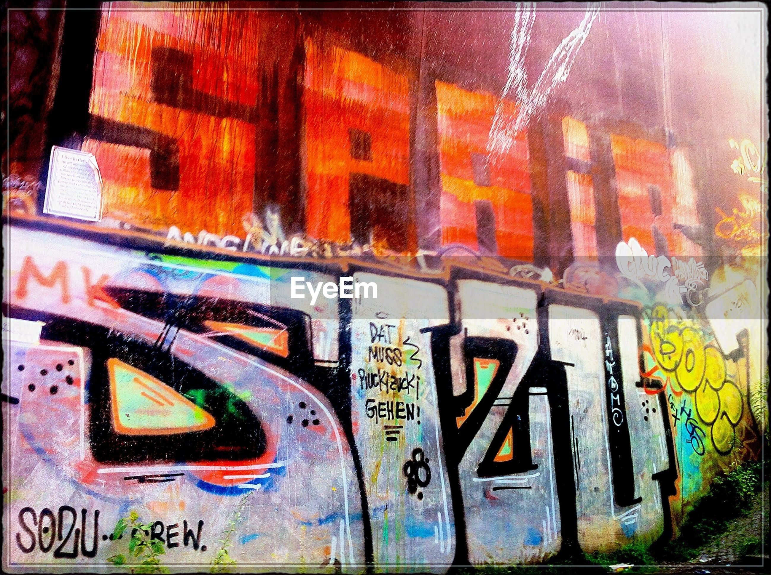 text, graffiti, western script, communication, capital letter, wall - building feature, built structure, architecture, art and craft, art, non-western script, creativity, wall, information, street art, building exterior, auto post production filter, multi colored, low angle view, close-up