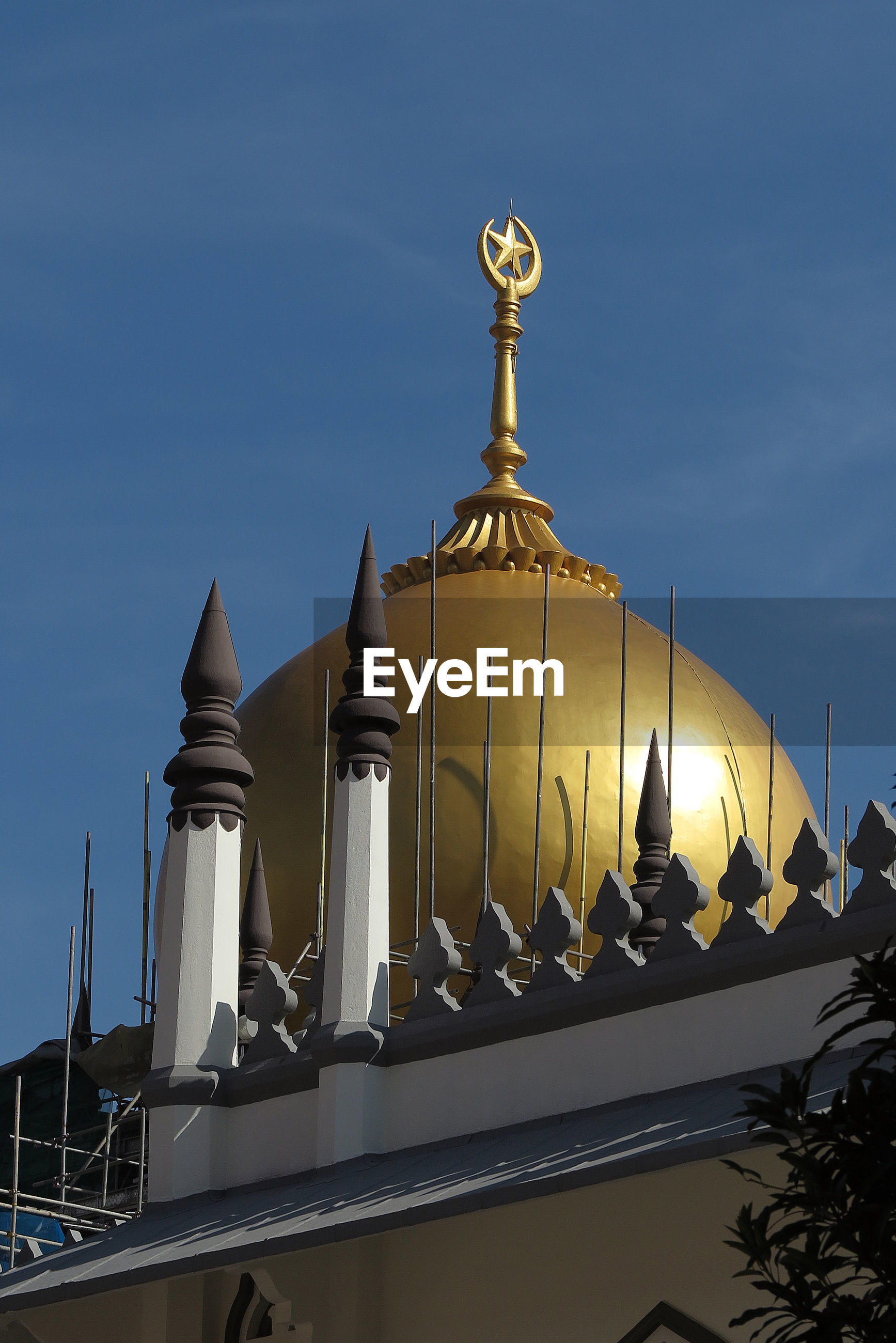 Golden dome of sultan mosque against blue sky