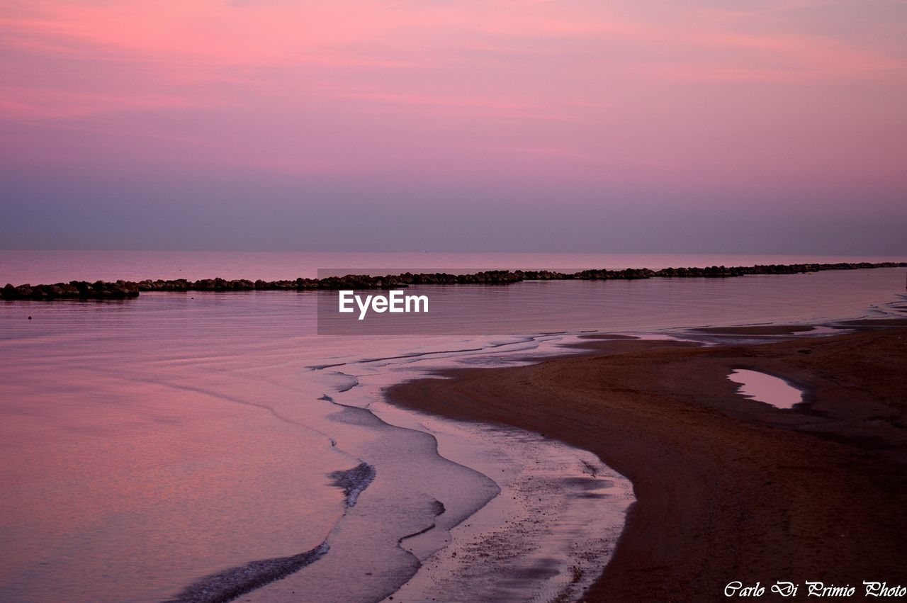 water, beauty in nature, sky, tranquil scene, sunset, tranquility, scenics - nature, beach, sea, nature, land, cloud - sky, idyllic, no people, non-urban scene, reflection, orange color, outdoors, sand, purple