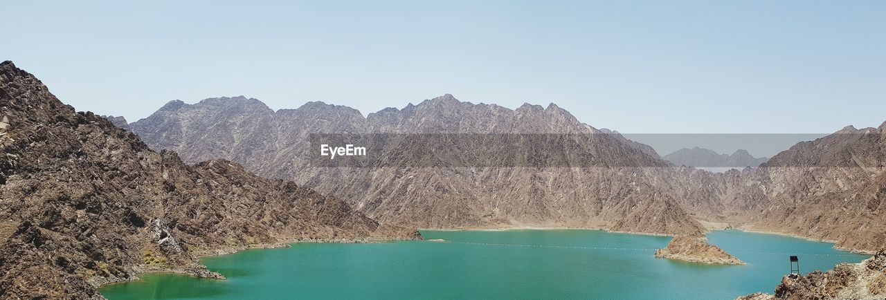 Panoramic view of lake and mountains against clear sky