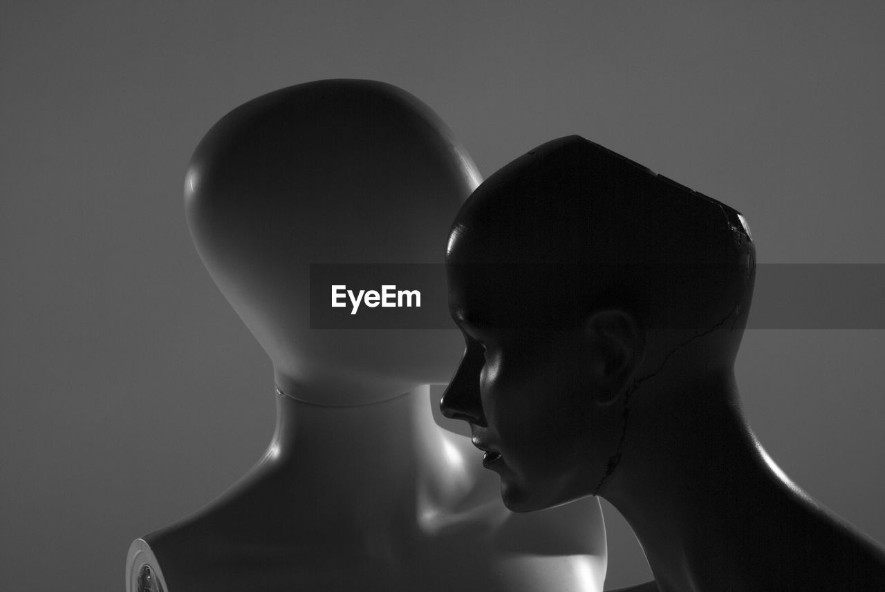 Close-Up Of Mannequins Against Gray Background