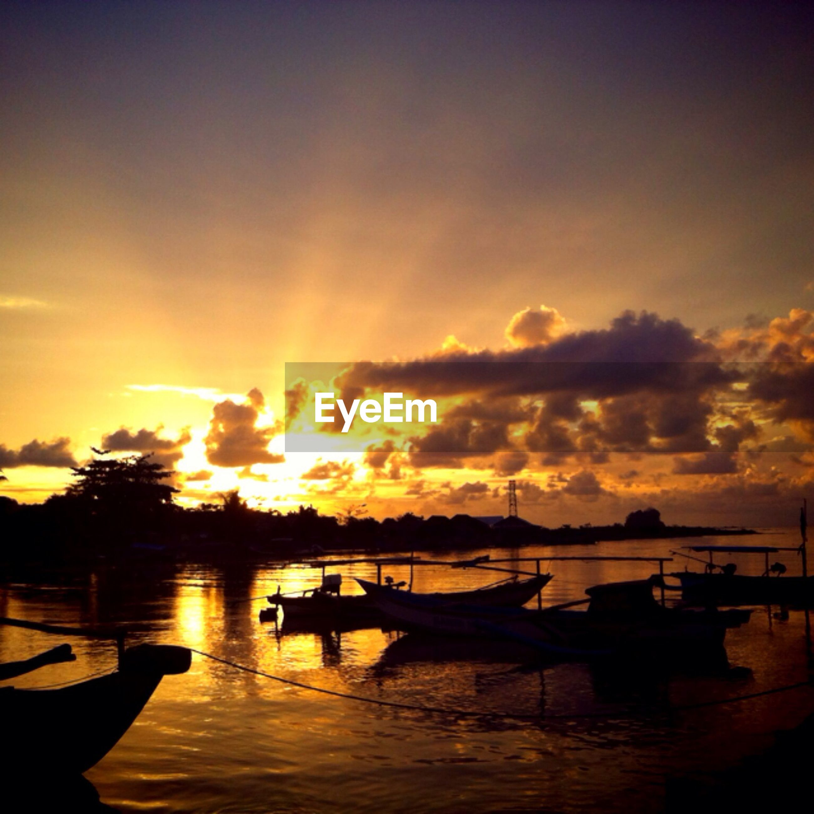sunset, nautical vessel, transportation, water, mode of transport, orange color, boat, sun, sky, moored, beauty in nature, scenics, sea, reflection, tranquil scene, tranquility, cloud - sky, nature, sunlight, silhouette