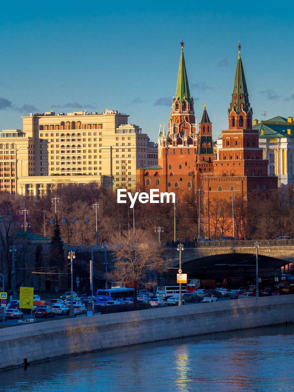 River against buildings in city