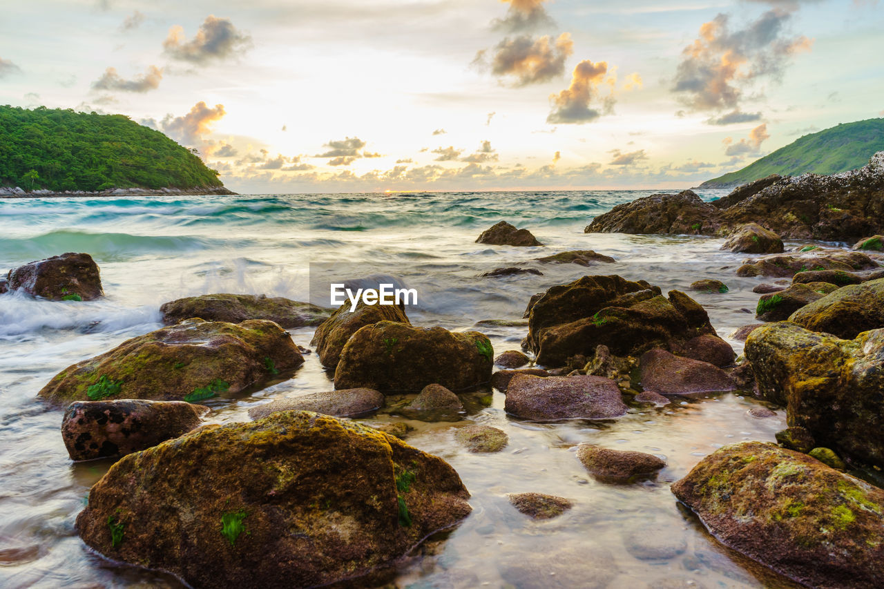 water, rock, sea, solid, sky, rock - object, beauty in nature, cloud - sky, scenics - nature, land, beach, nature, tranquility, no people, motion, tranquil scene, sunset, day, outdoors, pebble