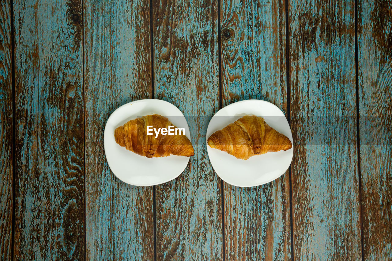 food and drink, wood - material, table, food, still life, no people, directly above, freshness, indoors, close-up, blue, wellbeing, ready-to-eat, healthy eating, high angle view, bread, plant, pattern, day, wood