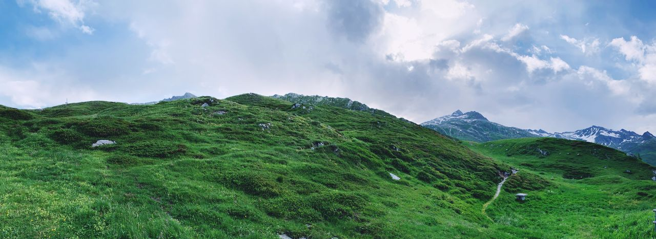 cloud - sky, scenics - nature, sky, green color, beauty in nature, tranquil scene, tranquility, mountain, environment, plant, landscape, grass, non-urban scene, nature, land, no people, day, idyllic, growth, outdoors, mountain peak