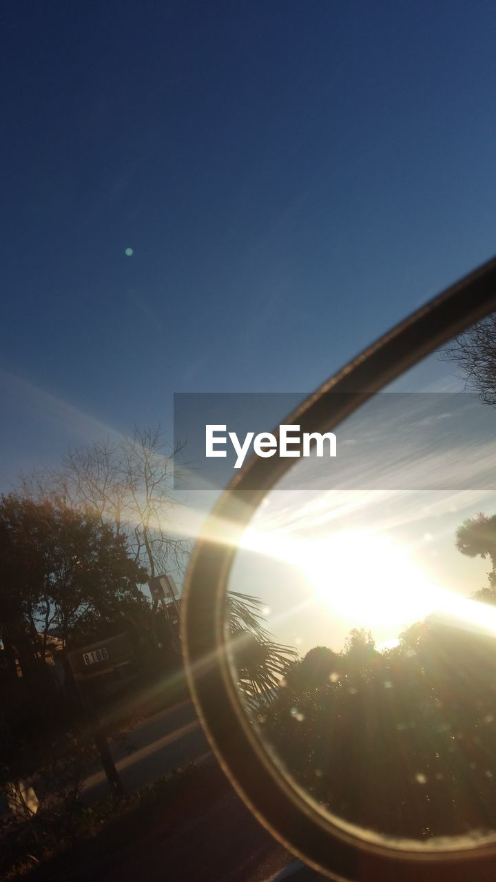 lens flare, sun, sky, no people, tree, outdoors, technology, nature, close-up, day