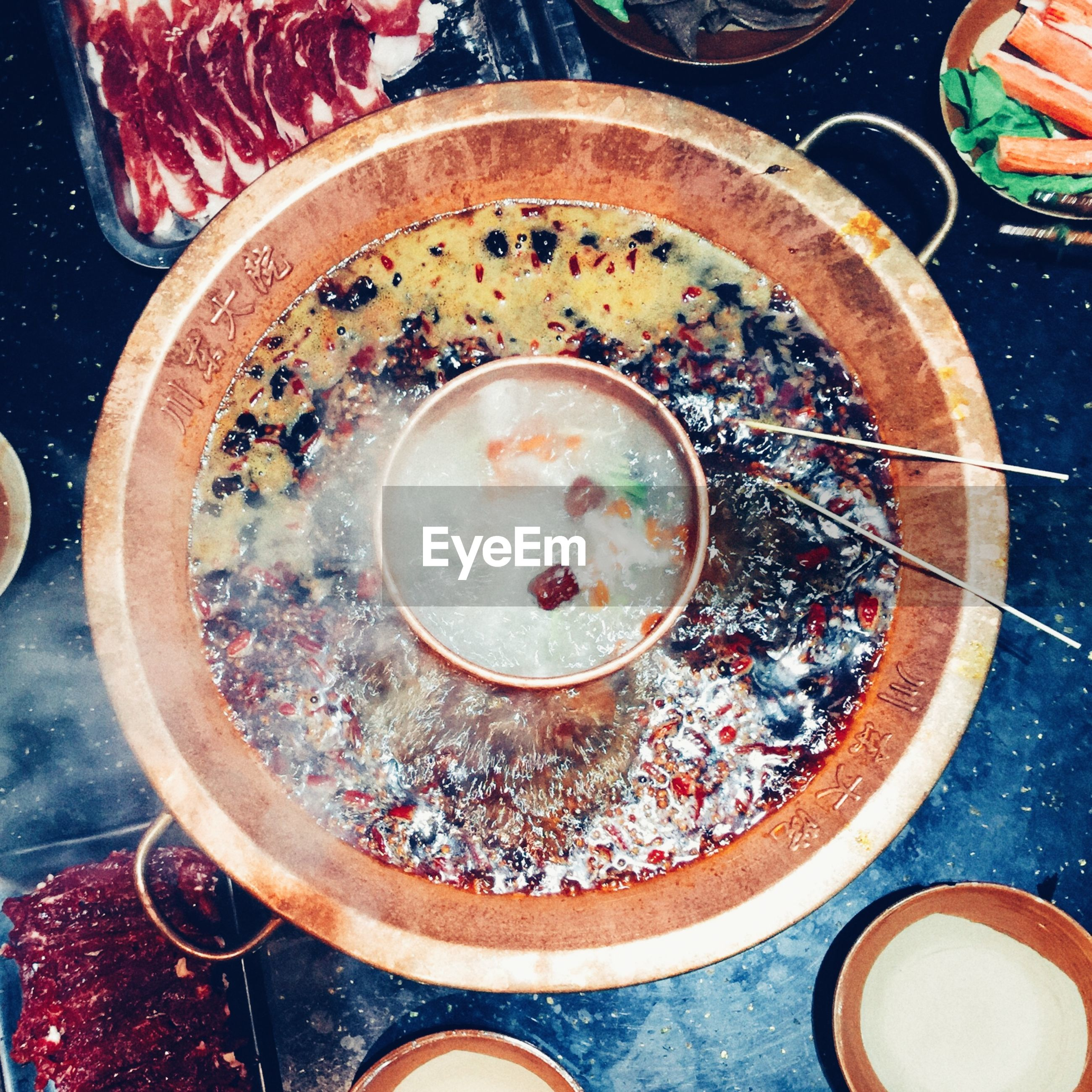 indoors, high angle view, food and drink, directly above, freshness, circle, table, food, bowl, still life, plate, close-up, ready-to-eat, healthy eating, overhead view, no people, spoon, drink, elevated view, soup