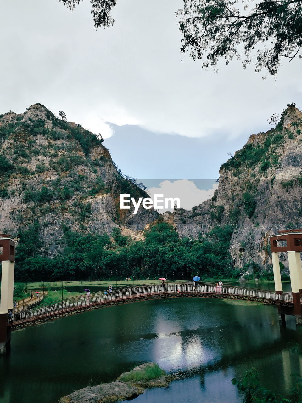 Scenic View Of River With Mountain In Background
