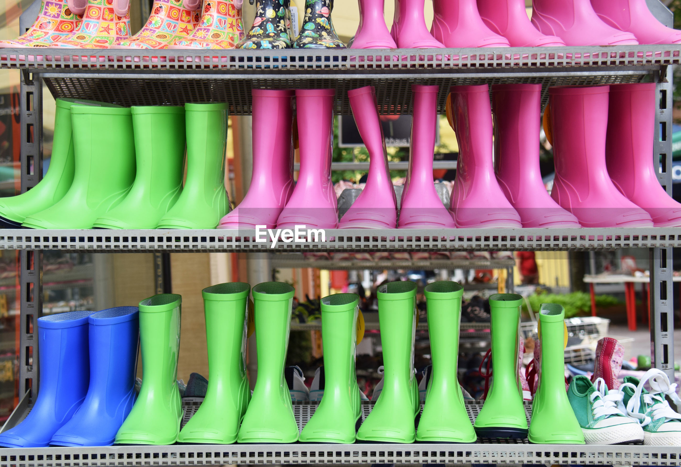 Rubber boots for sale at market stall
