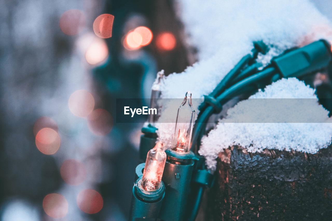 Close-Up Of Snow On Christmas Lights